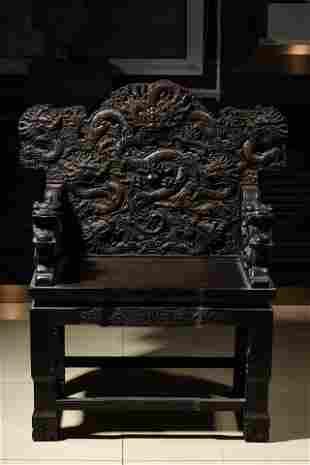 An used Carved Hardwood wood Dragon Chair