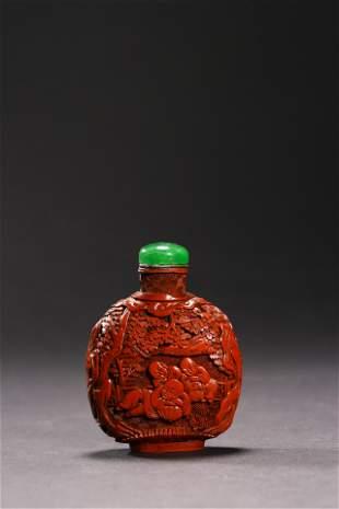 Qianlong Period; A Cinnabar Lacquer Snuff Bottle .