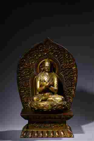 A Ming Styled Gilt bronze Buddha Statue with lotus