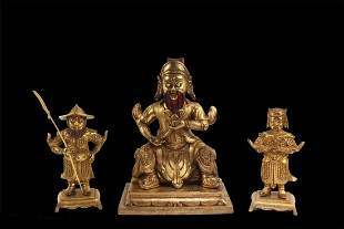 A Group of Three Bronze Deity Statues