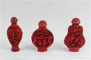 A Group of Three Cinnabar Snuff Bottles