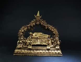 A gilt, bronze figure of Buddha at Nirvana with ten