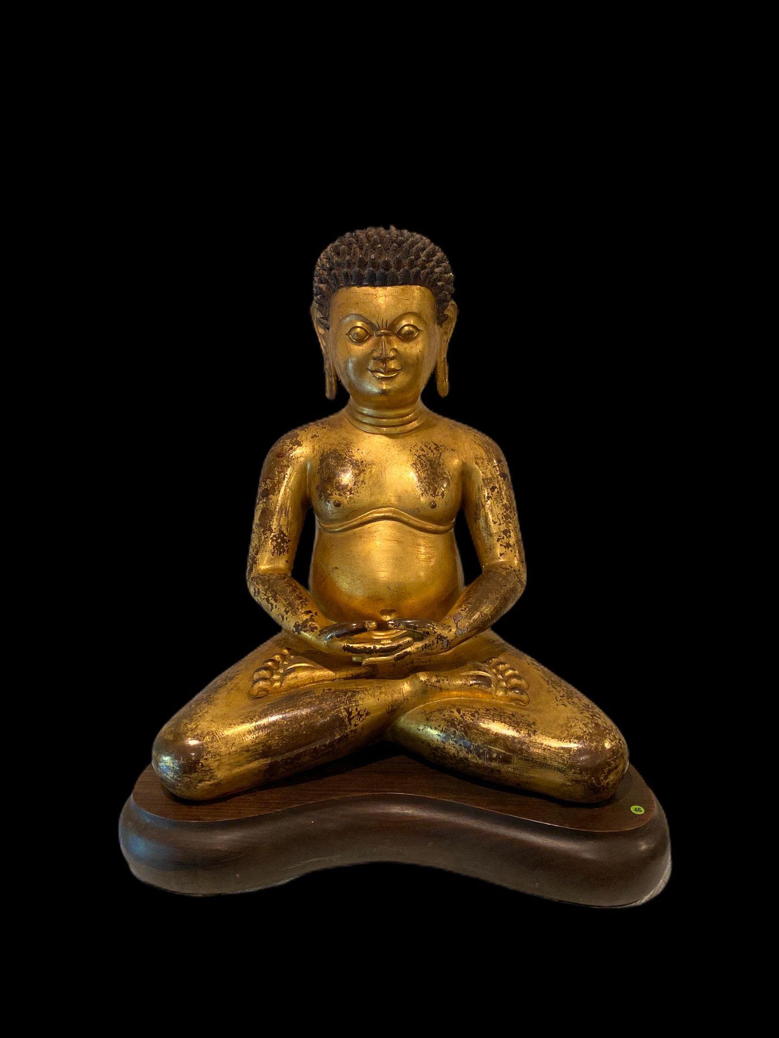 A Gilt Bronze Seated Buddha Statue