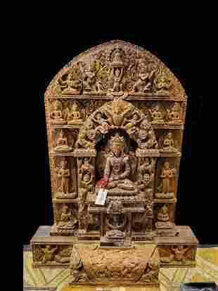 A hand carved Teak wood figure of Buddha touching earth