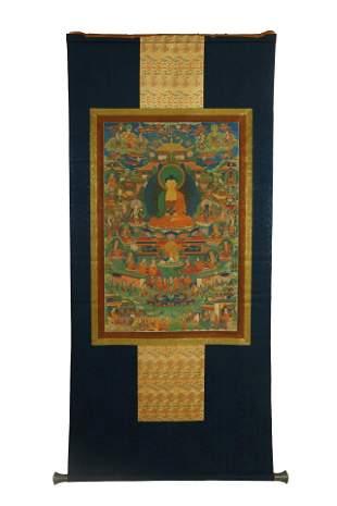 A TIBETAN THANGKA ON SILK FRAME