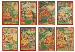 A SET OF EIGHT TIBETAN THANGKA ON SILK FRAME