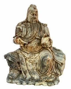 A Carved Jade Guanyu Statue