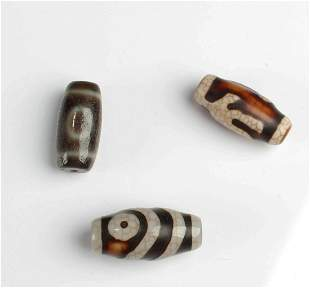 A Group of Three Dzi Beads