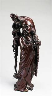 A Carved Wooden Figurine