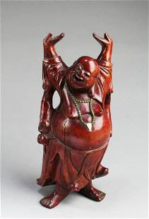 A Carved Wooden Deity Figurine