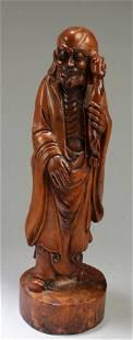 A Carved HuangYangMu Damo Statue
