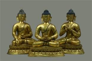 A Group of Three Gilt Bronze Buddha Statues