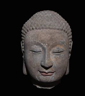 A Carved Stone Buddha Head