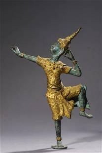A Bronze and Gilt Bronze Nepalese Figurine