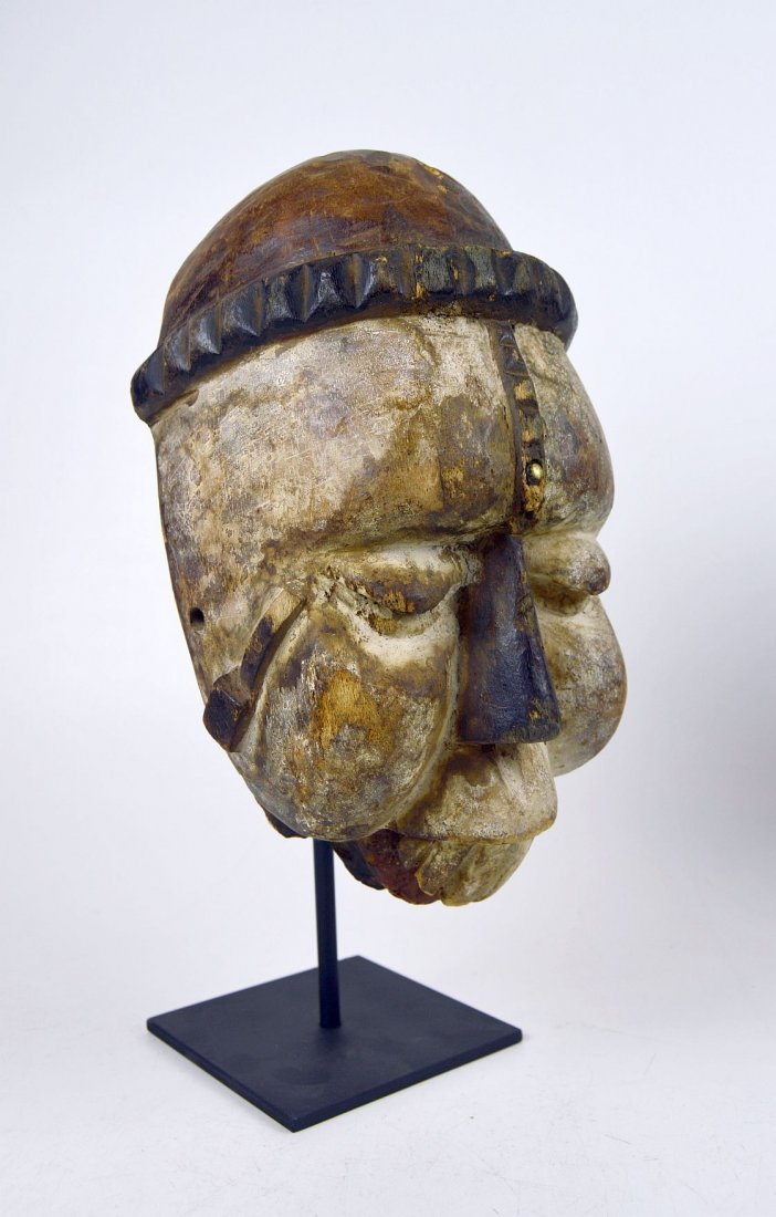Carved wooden African mask from the Ibibio of Nigeria
