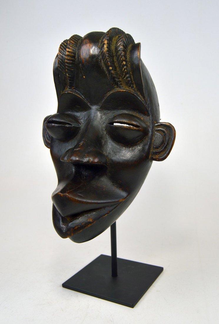 A Whimsical Dan Bassa African mask
