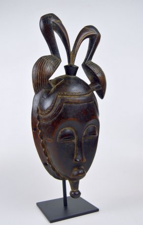 A Fine Baule African mask with Avian finial