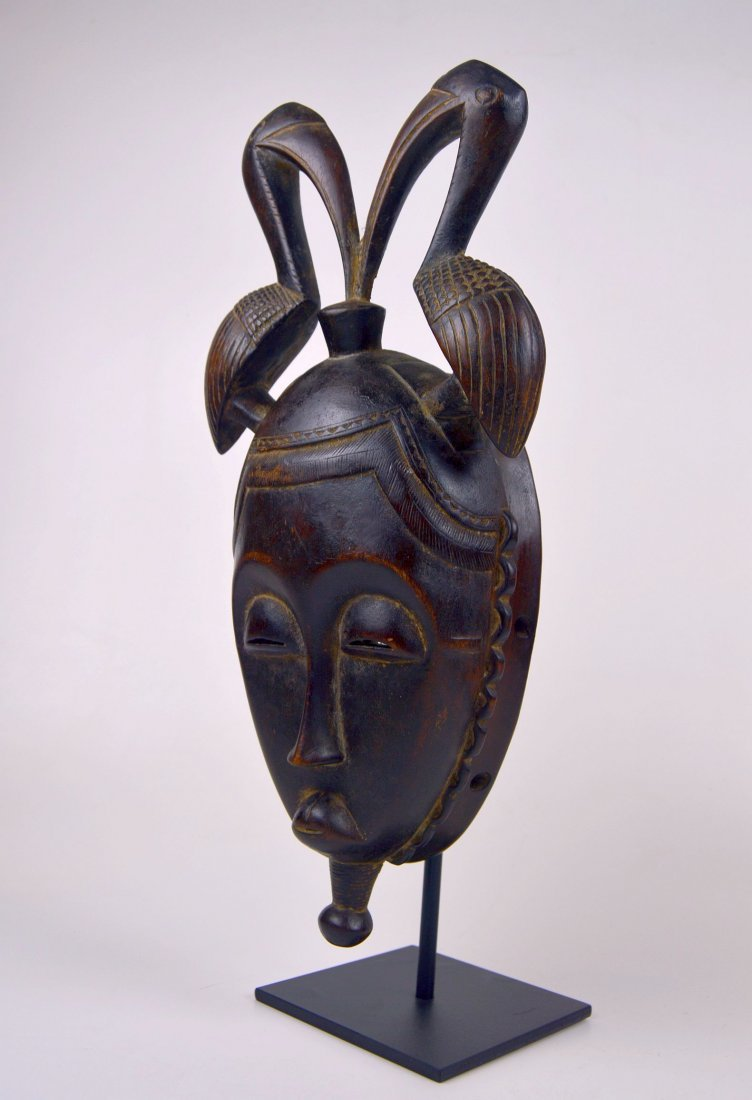 A Fine Baule African mask with Avian finial - 2