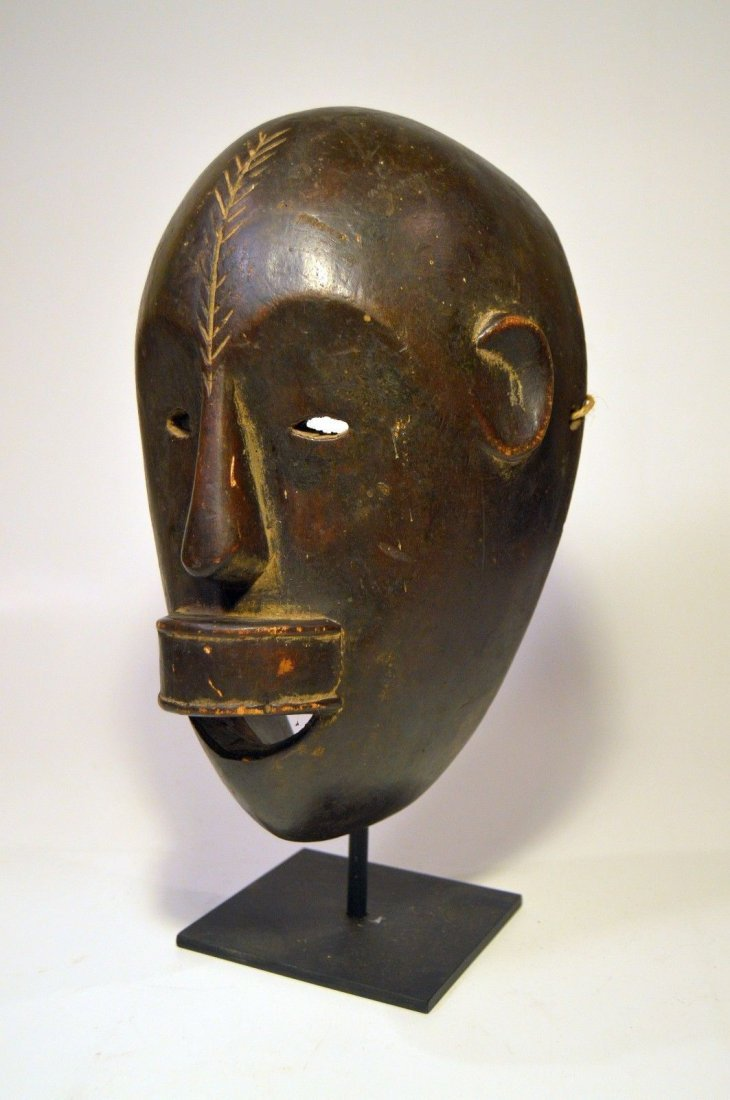 Fine Sukuma African mask on display stand, African Art