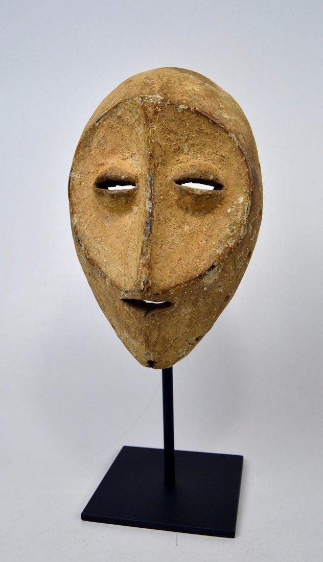 White faced Lega African mask