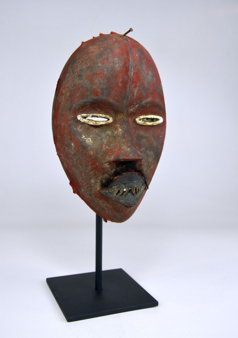 A Stunning Red Poro DAN African mask