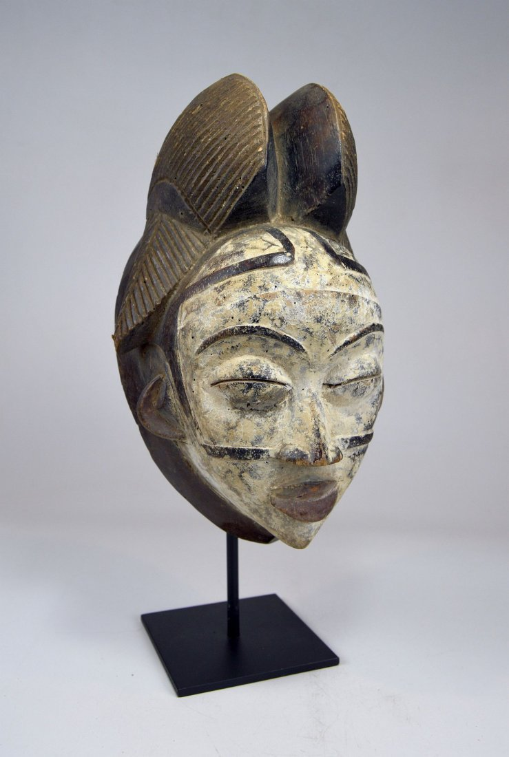 A Punu Mukudj African mask with painted facial designs