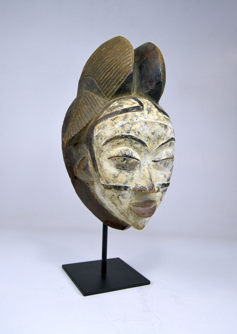 A Punu Mukudj African mask with painted facial designs - 2
