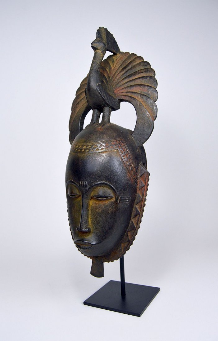 A Lovely Baule African mask with Avian finial