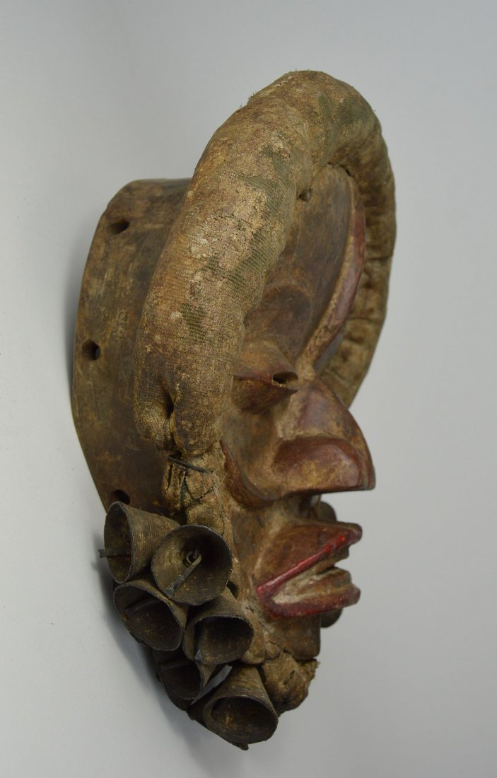 A Dan African mask adorned with Bronze Bells - 4