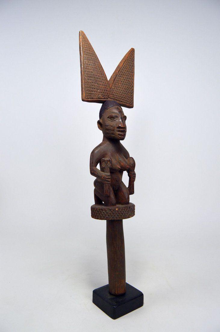 A Yoruba Shango staff with kneeling Devotee