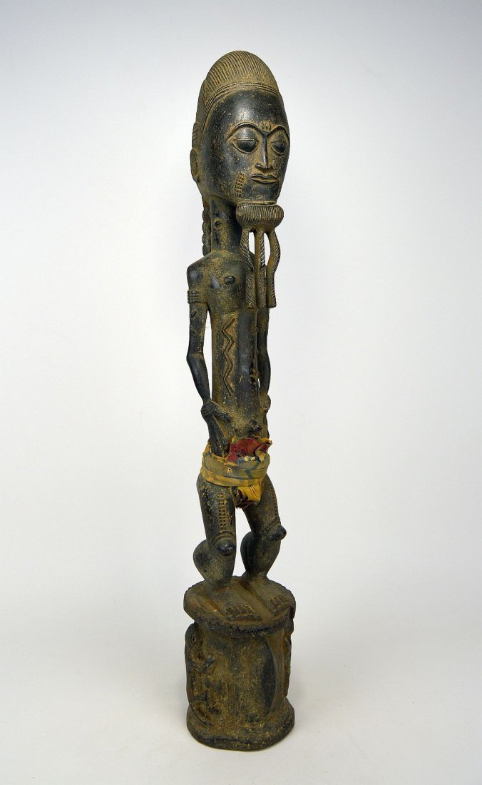 Tall ornately carved Baule Male sculpture