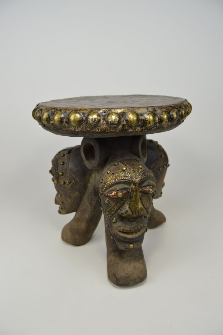 A Songye ceremonial stool with mask faces - 4