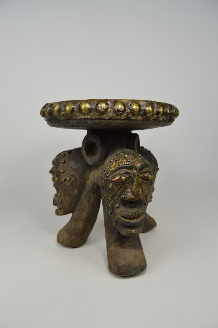 A Songye ceremonial stool with mask faces - 5