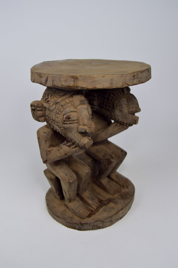 A Songye ceremonial stool with mask faces - 7