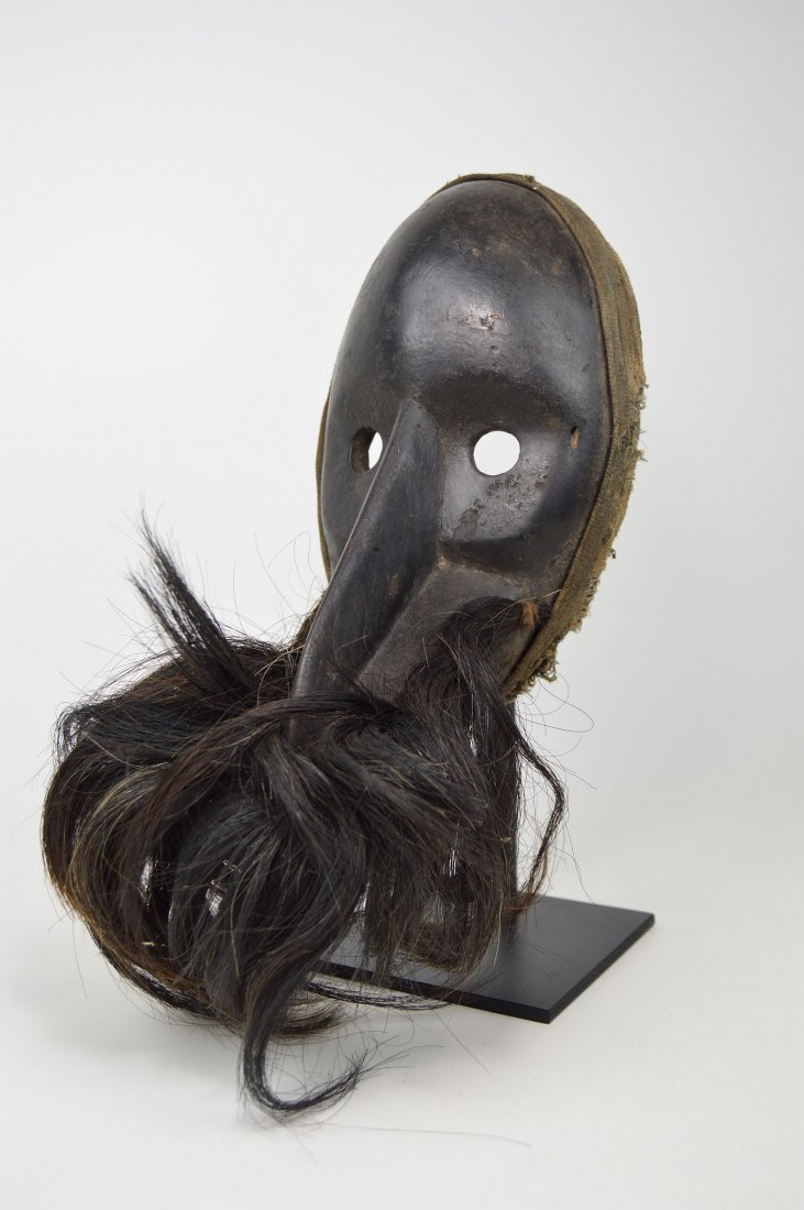 A Dan Gagon African mask with animal fur
