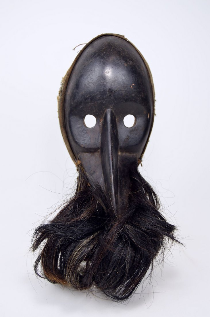 A Dan Gagon African mask with animal fur - 2