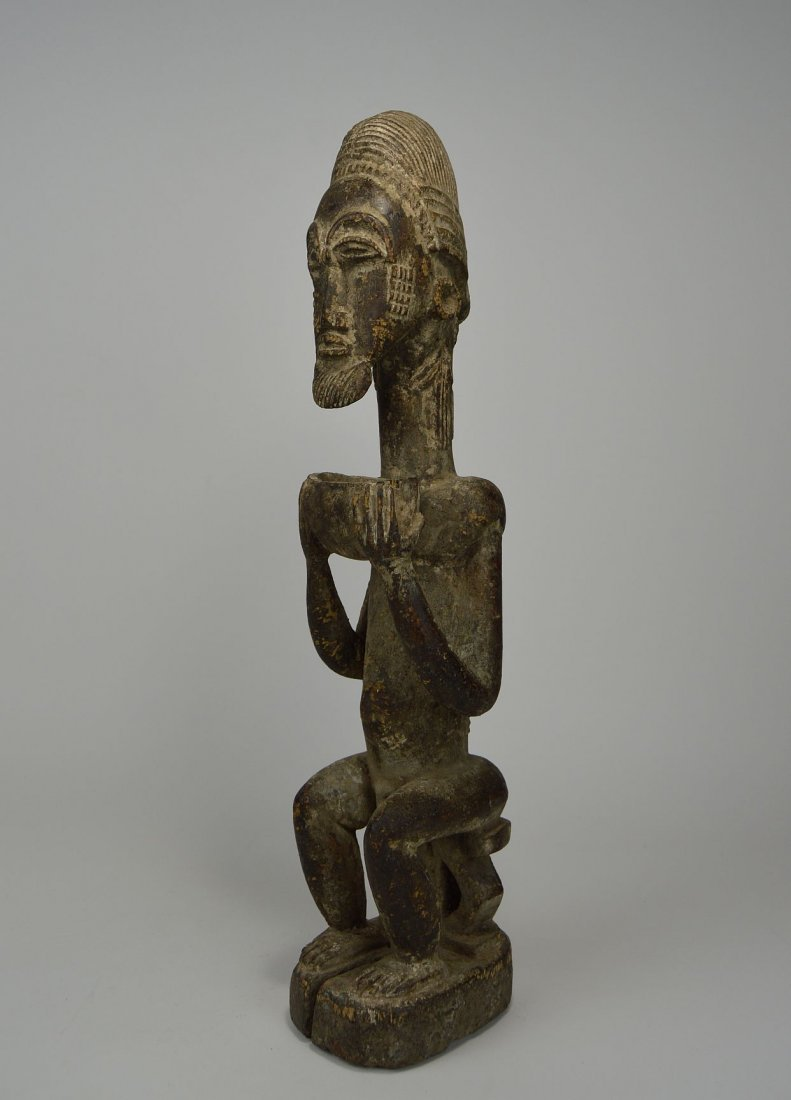Carved wooden male ancestor with offering bowl