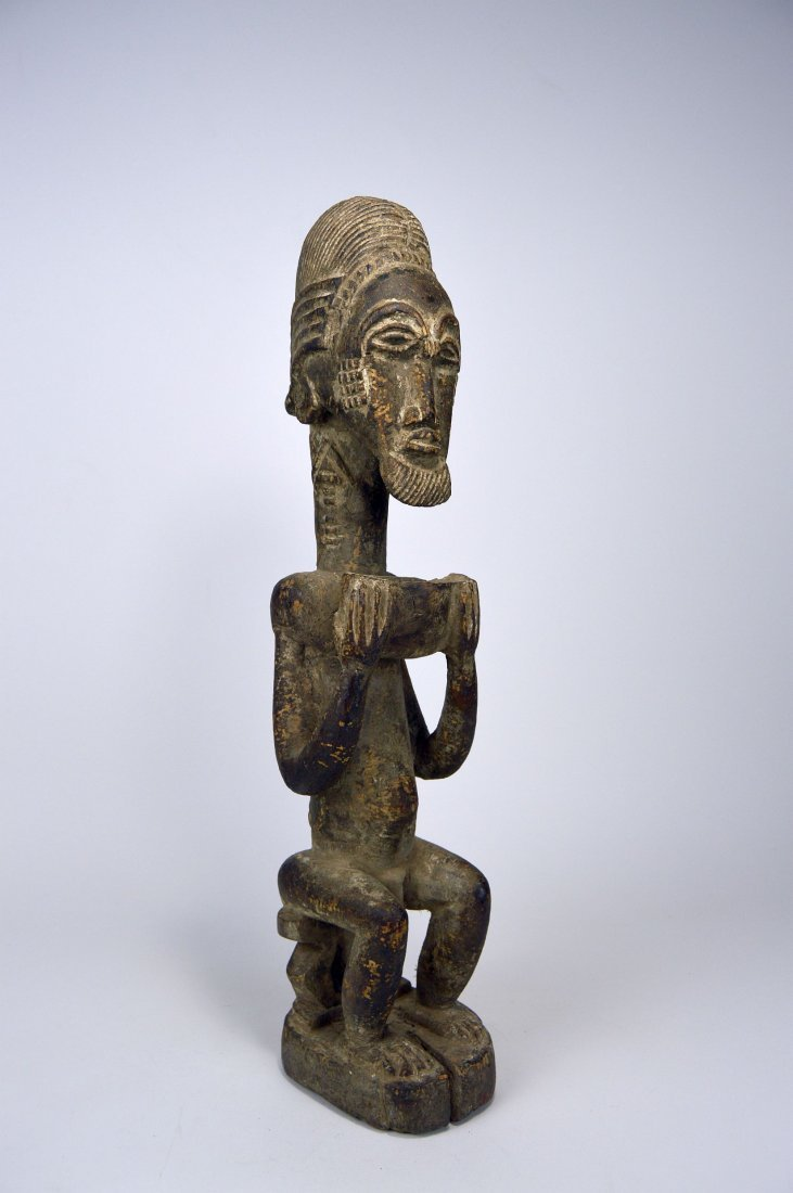 Carved wooden male ancestor with offering bowl - 2