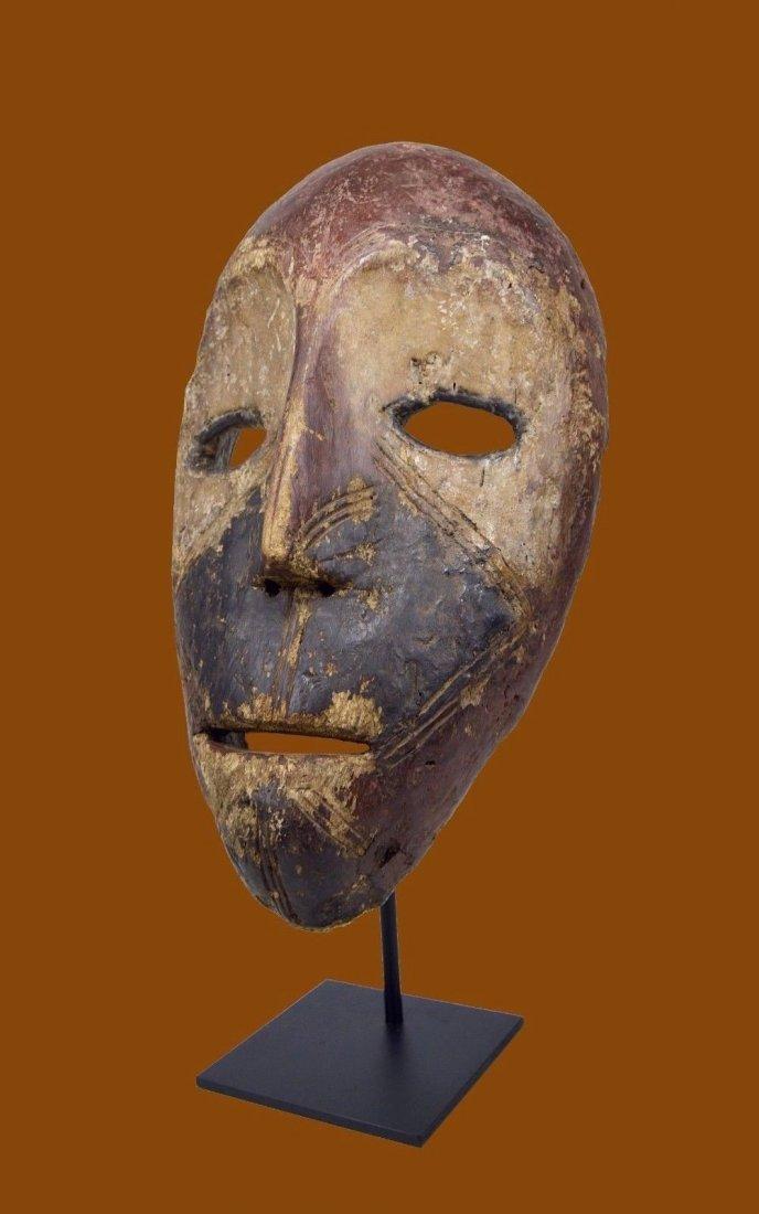 Eroded old Kumu African mask, African Art
