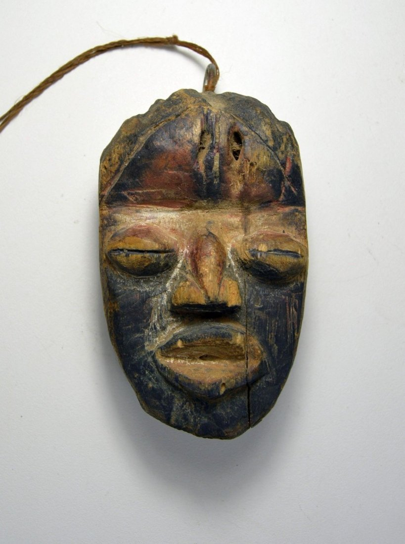 A Rare Old Dan Passport African Mask