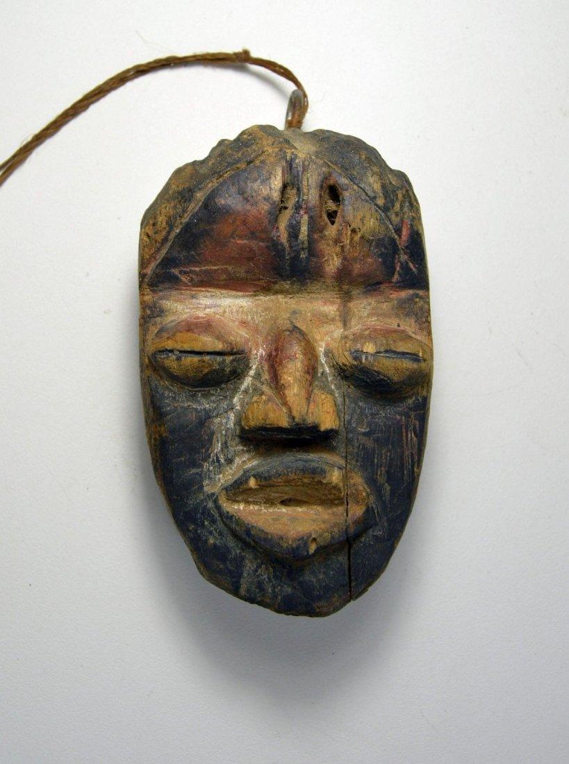 A Rare Old Dan Passport African Mask