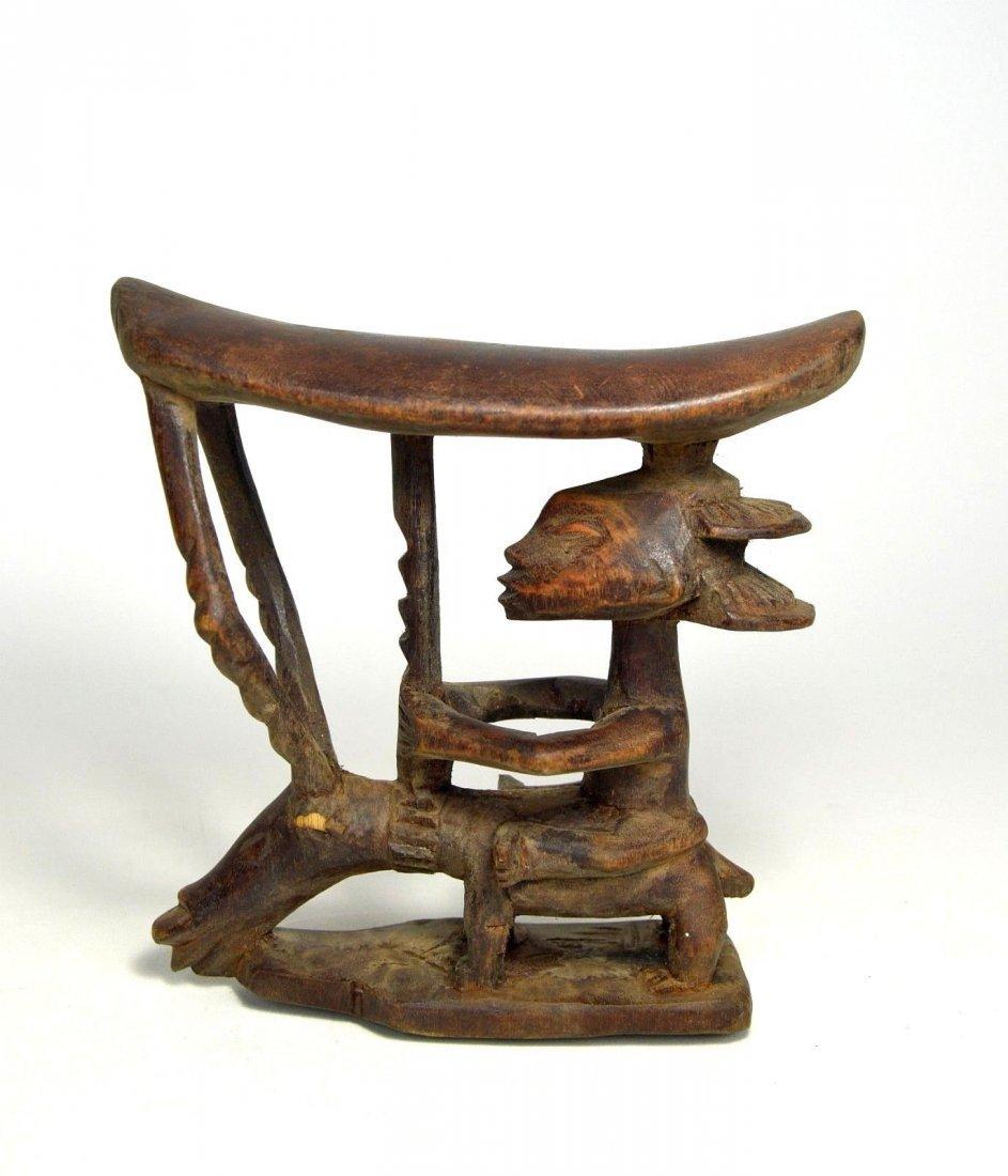 A Charming Luba headrest with Antelope & Ancestor