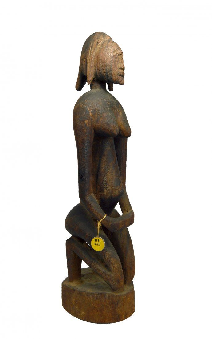 A Rare Dogon Kneeling Female Ex Sotheby