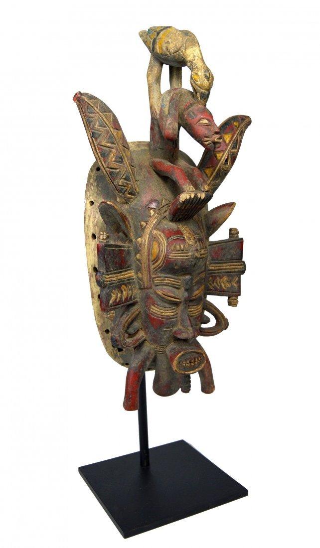 A Fine Senufo Kpeliye'e Mask with Bird attacking Man