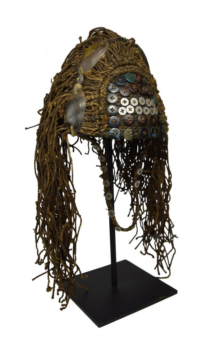 A Fine Lega Woven Grass hat with shells and buttons