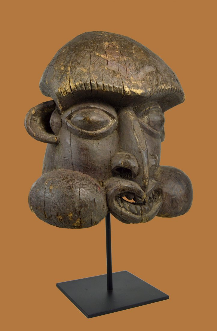 Old Bamileke Helmet mask with Classic Cheeky Face