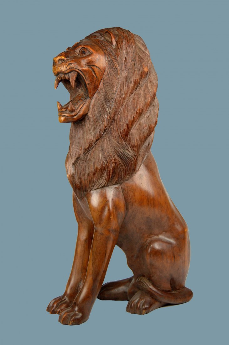 A Large and Finely Craved Wooden Lion Sculpture