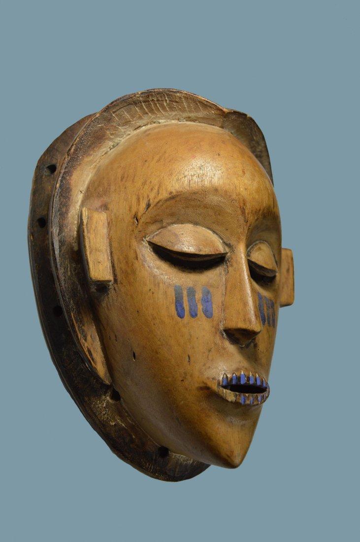 A Serene Kusu African Mask