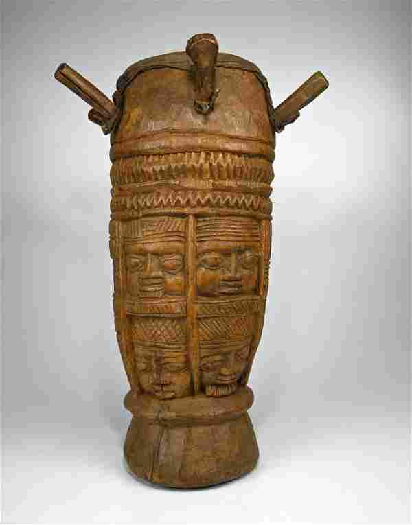A Fine Old Yoruba Drum with 8 Ancestor faces