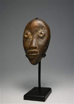 A Fine Dan Toma Passport mask Ex Charles Jones Gallery